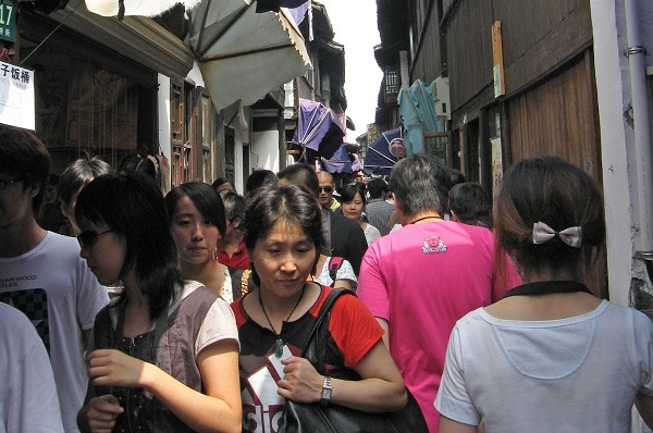 Crowded alley filled with shops