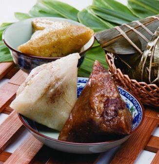 Zongzi is steamed rice with tasty morsels inside.