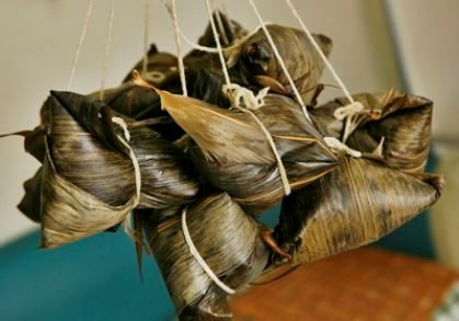 Zongzi is rice wrapped in bamboo leaves, then steamed or boiled.