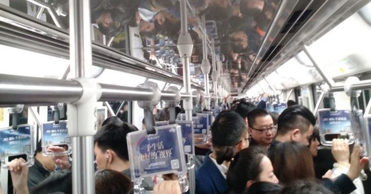 Reflection on a crowded subway.