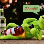 Kermit opening a bottle